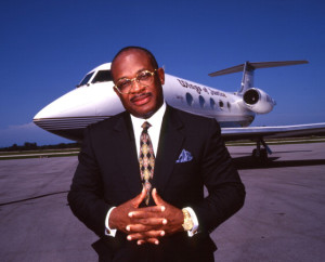 Portrait of lawyer Willie E. Gary standing in front of his private jet 'Wings of Justice', on an unidentified airport in Florida, late twentieth century. (Photo by Anthony Barboza/Getty Images)